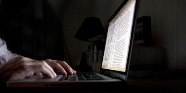 Hands writing on a laptop an