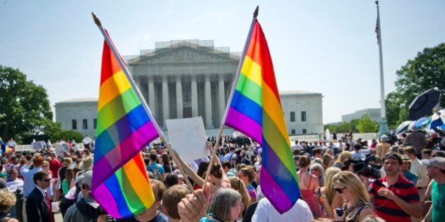 Hundreds of people gather outside the US Supreme Court building in Washington, DC on June 26, 2013 in...