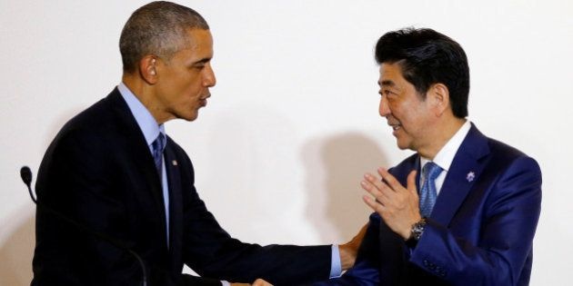 U.S. President Barack Obama shakes hands with Japan's Prime Minister Shinzo Abe during a press conference...