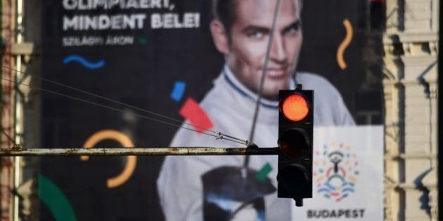 This picture taken on January 17, 2017 in Budapest shows a poster of Hungarian Olympic winner of sabre...