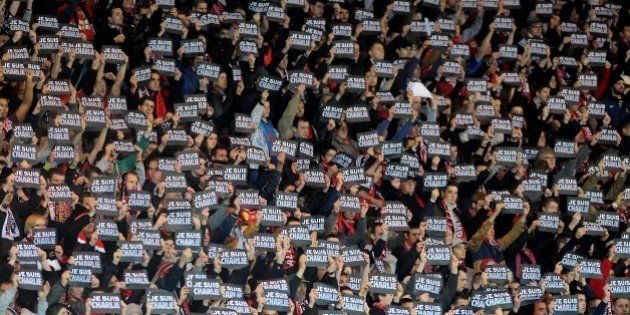 Guingamp's supporter hold signs reading 'Je suis Charlie' (I am Charlie) to pay tribute to the victims...