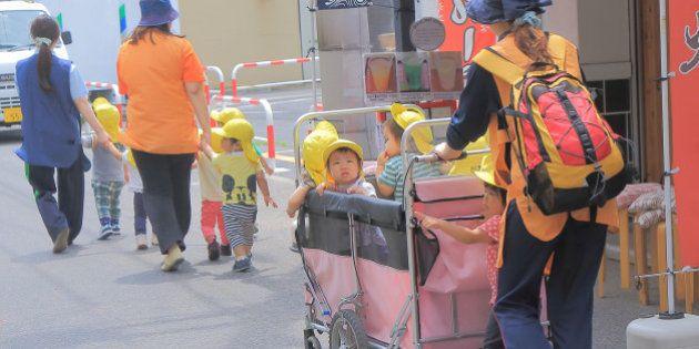 Tokyo Japan - May 22, 2015: Japanese kindergarden kids and teachers walk on street in Asakusa Tokyo