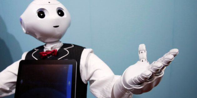SoftBank humanoid robot known as Pepper dressed as a waiter moves its hand at Pepper World 2016 Summer...