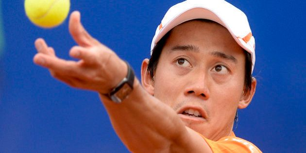 Japan's Kei Nishikori serves the ball to France's Jeremy Chardy during the ATP Barcelona Open 'Conde...