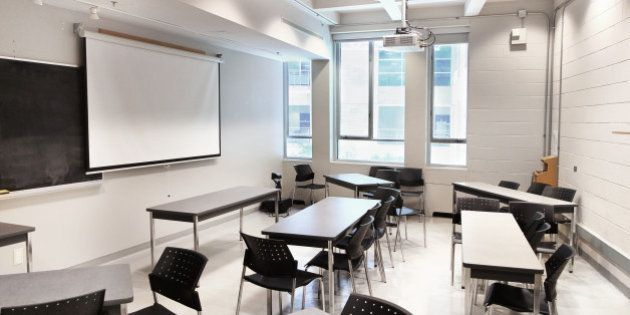 A modern university lecture hall and classroom space set up with movable tables for running a 'seminar'...
