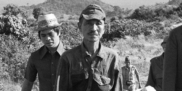 This picture taken on March 11, 1974 shows former Japanese imperial army soldier Hiroo Onoda (2nd L)...