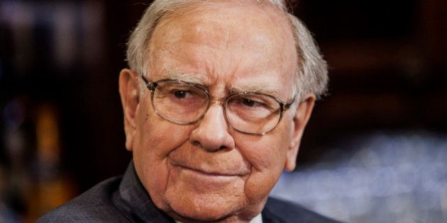 Warren Buffett, chairman and chief executive officer of Berkshire Hathaway Inc., listens during a Bloomberg...