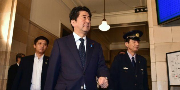 Japanese Prime Minister Shinzo Abe arrives at the Upper House's ad hoc committee session for the controversial...