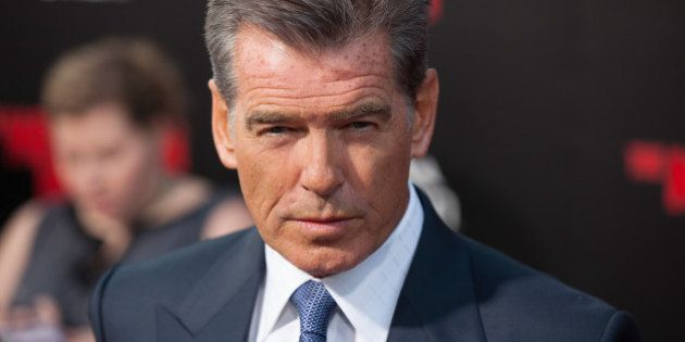 HOLLYWOOD, CA - AUGUST 13: Pierce Brosnan arrives for the Premiere Of Relativity Media's 'The November...