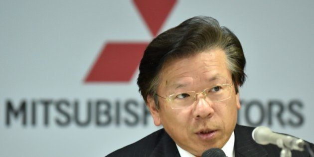 Japan's Mitsubishi Motors Corporation (MMC) President and Chief Operating Officer Tetsuro Aikawa answers...