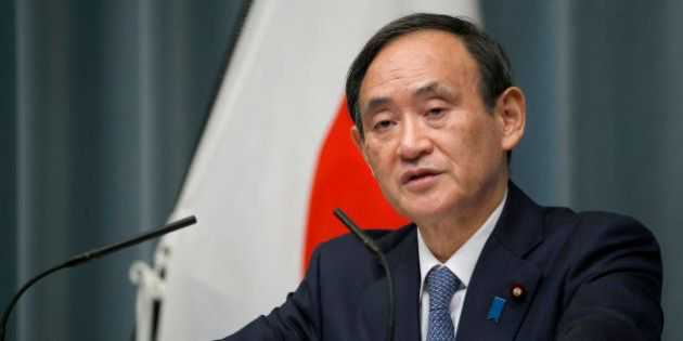 FILE - In this Feb. 10, 2016, file photo, Japan's Chief Cabinet Secretary Yoshihide Suga speaks to the...