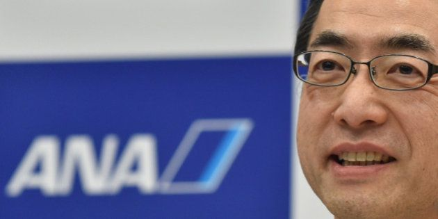 Yuji Hirako, newly-named president of Japanese airline All Nippon Airways (ANA), answers questions during...