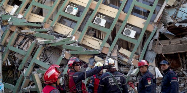 Rescue workers from Venezuela organize themselves before they search for earthquake survivors in Portoviejo,...