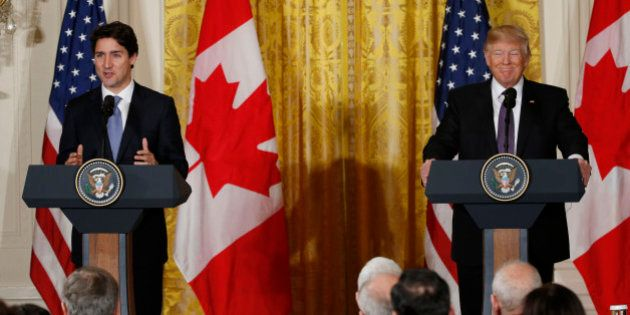 Canadian Prime Minister Justin Trudeau (L) and U.S. President Donald Trump participate in a joint news...