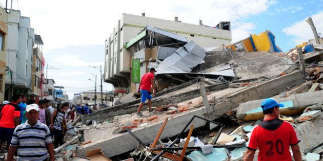 Local residents and rescue workers in the city of Manta in Manabi province search on April 17, 2016 through...