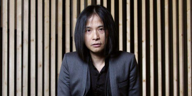 Japanese writer Hitonari Tsuji poses during the inauguration of the 32th Paris' book fair, on March 15,...