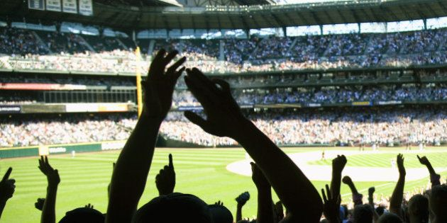 Baseball fans cheering in