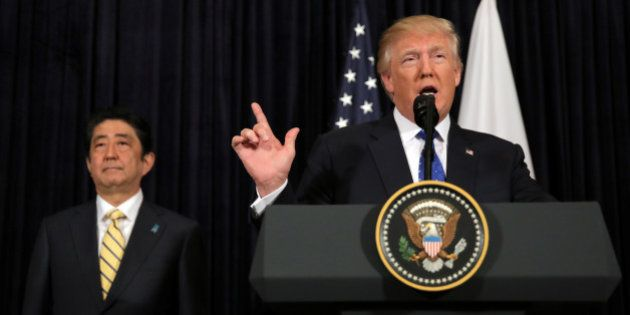 U.S. President Donald Trump delivers remarks on North Korea accompanied by Japanese Prime Minister Shinzo...