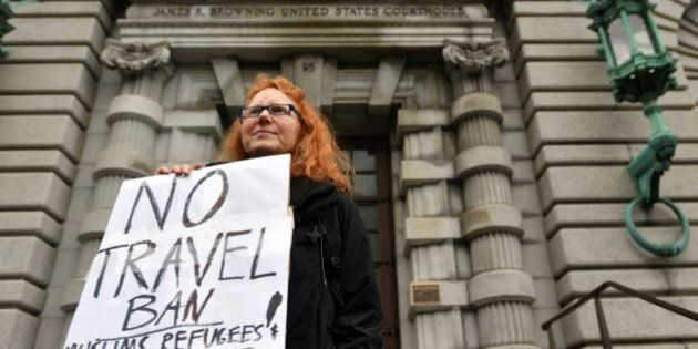 Beth Kohn holds up a sign in front of the United States Court of Appeals for the Ninth Circuit in San...