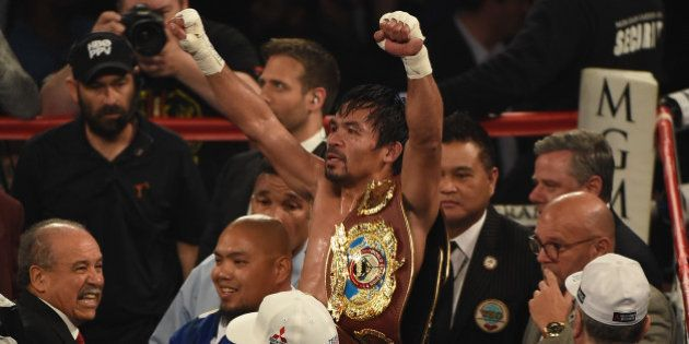 LAS VEGAS, NEVADA - APRIL 09: Manny Pacquiao celebrates after defeating Timothy Bradley Jr. in their...