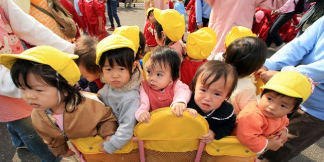 NAGOYA, JAPAN - NOVEMBER 09: Children from a nursery school gather at the Port of Nagoya to see the arrival...