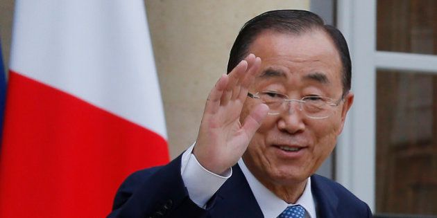 United Nations Secretary-General Ban Ki-moon, waves to the media after a working lunch with French President...