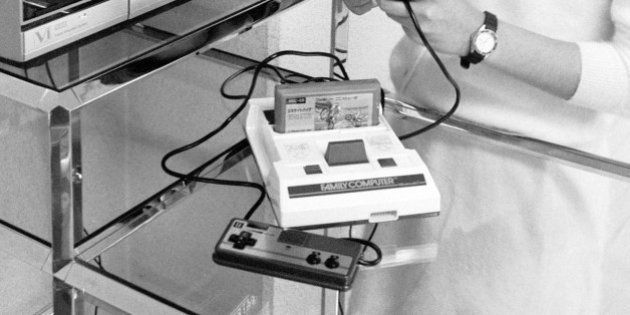 JAPAN: A model plays Nintendo's Family Computer on January 30, 1985 in Japan. Family Computer was on...