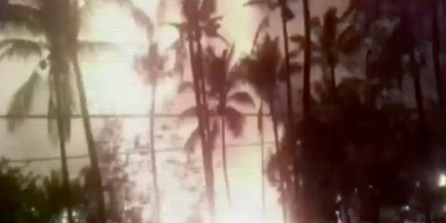 In this image made from video, a flash from an explosion is seen from the ground during a fireworks show...