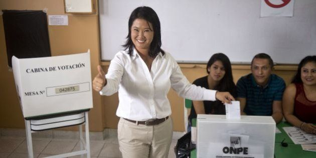 Peru´s presidential candidate, Keiko Fujimori, casts her vote during general elections, in Lima on April...