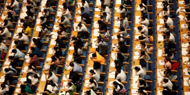 Students attend a lecture for the entrance exam for postgraduate studies at a hall in Jinan, Shandong...