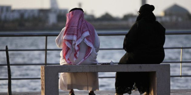 In this Sunday, May 11, 2014 photo, a Saudi couple sit on a bench overlooking the sea, in Jiddah, Saudi...