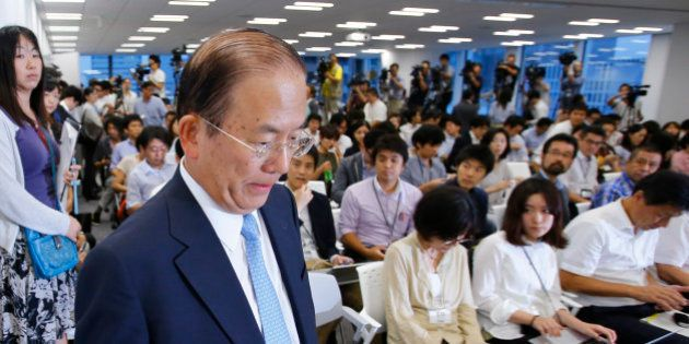 Tokyo 2020 Olympics CEO Toshiro Muto arrives for a press conference in Tokyo, Tuesday, Sept. 1, 2015....