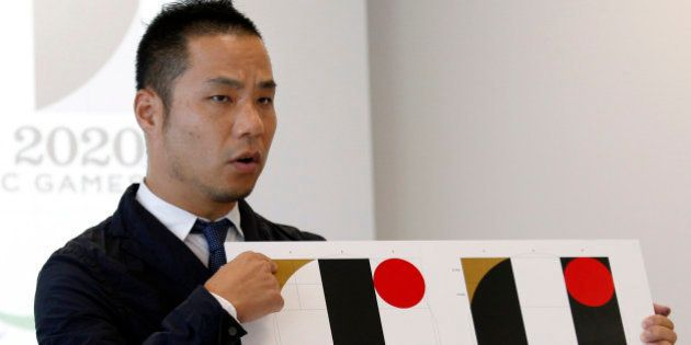 FILE - In this Aug. 5, 2015, file photo, Japanese designer Kenjiro Sano gives a detailed explanation...