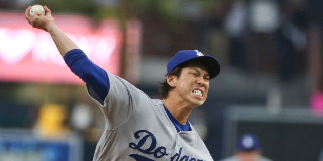 Los Angeles Dodgers starting pitcher Kenta Maeda throws against the San Diego Padres in the first inning...