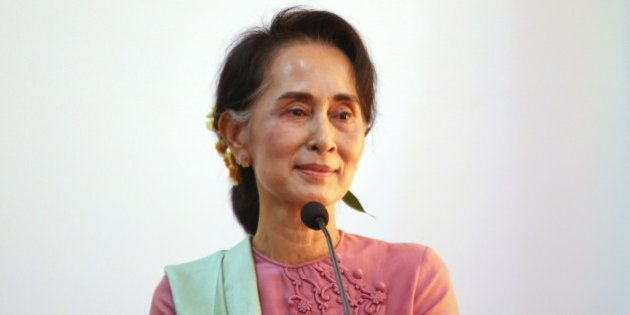 Myanmar foreign minister Aung San Suu Kyi smiles during joint press conference with Chinese Foreign Minister...