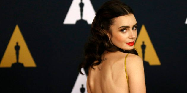 Actress Lily Collins arrives at the 8th Annual Governors Awards in Los Angeles, California, U.S., November...