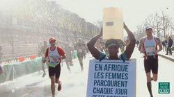 女性はマラソンで歩き続けた。19リットルの水を頭に乗せて。