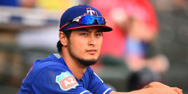 SURPRISE, AZ - MARCH 06: Yu Darvish of Texas Rangers looks on before the spring training game between...