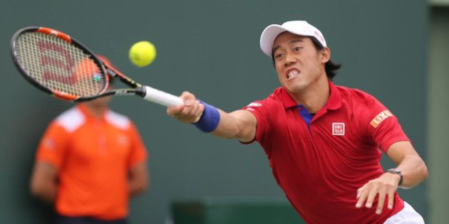 Japan's Kei Nishikori returns a shot against Serbia's Novak Djokovic in the finals of the Miami Open...
