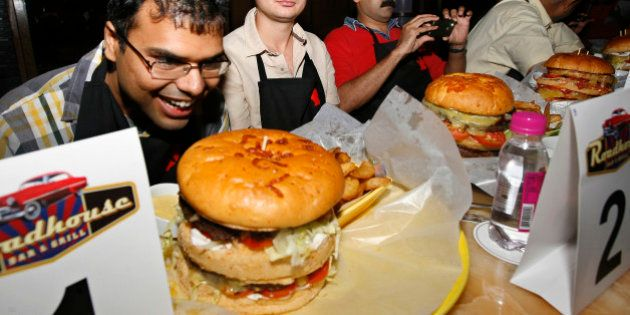 NEW DELHI, INDIA - JULY 04: Burger Demolition competition at Roadhouse Bar and Grill at Doubletree by...