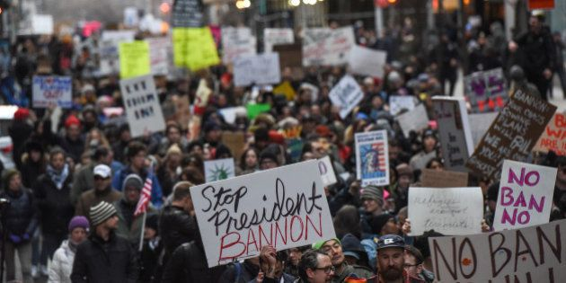 People participate in a protest against President Donald Trump's travel ban in New York City, U.S. January...