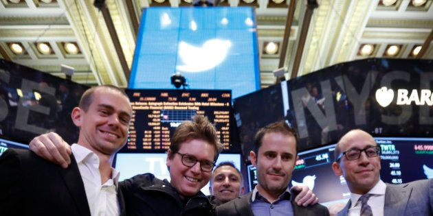 Twitter CEO Dick Costolo (R) celebrates the Twitter IPO with Twitter founders Jack Dorsey (L), Biz Stone...