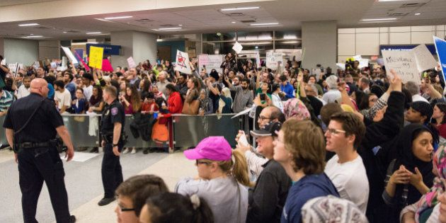 People gather to protest against the travel ban imposed by U.S. President Donald Trump's executive order,...