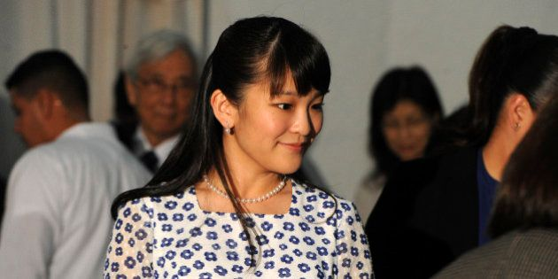 Japanese Princess Mako (C) attends a concert at the National School of Music in Tegucigalpa, on December...