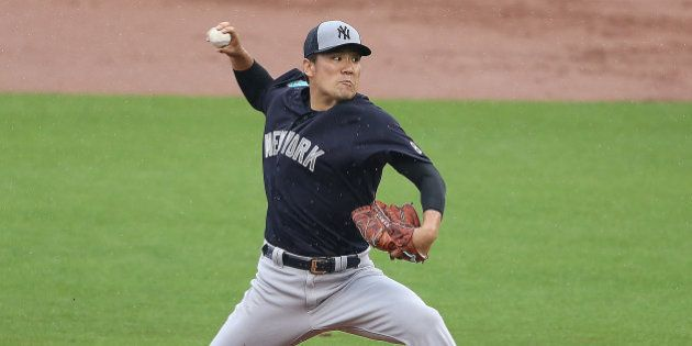 CLEARWATER, FL - MARCH 29: Masahiro Tanaka #19 of the New York Yankees pitches during the second inning...