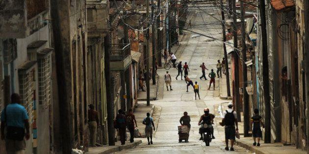 SANTIAGO DE CUBA, CUBA - MARCH 24: People fill the street in a busy downtown neighborhood on March 24,...
