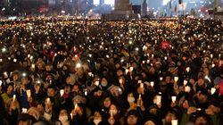 蝋燭を灯す韓国の若者へ