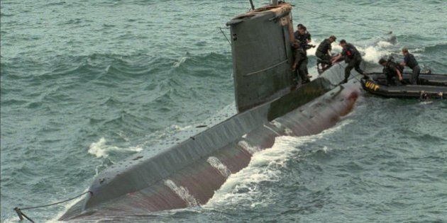 South Korean soldiers take to a North Korean submarine which was found stranded on a reef on South Korea's...