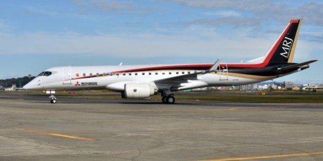 Japan's first domestically produced passenger jet, the Mitsubishi Regional Jet (MRJ), arrives at Nagoya...