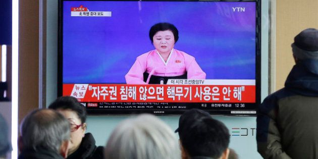 FILE - In this Wednesday, Jan. 6, 2016, file photo, people watch a TV news program showing North Korea's...